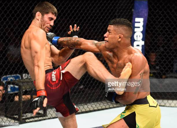 Gilbert Burns of Brasil punches Jason Saggo of Canada in their lightweight bout during the UFC Fight Night event inside the PPG Paints Arena on...