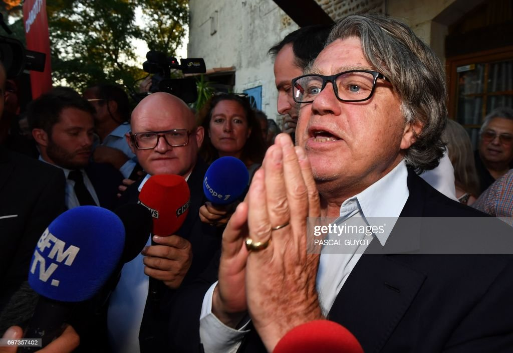 Gilbert Collard, French lawyer and far-right Front National (FN) party's candidate in the 2nd constituency of Gard department for the French parliamentary elections, reacts after winning in the second round on June 18, 2017 in Gallician, southern France. French President Emmanuel Macron's centrist party and its allies are on track for a huge majority in parliament, winning 355-425 seats in the 577-strong national assembly, polls showed on June 18. /