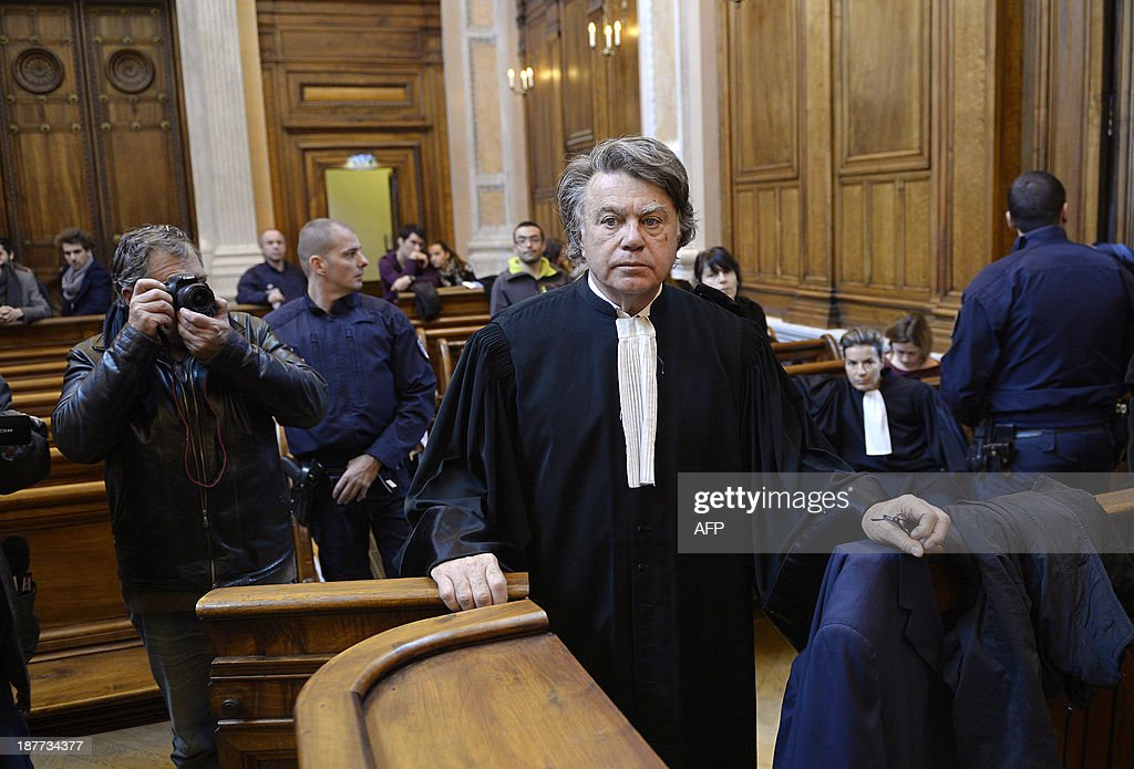 Gilbert Collard, lawyer of Valentin's mother Veronique Cremault, arrives at the Lyon courthouse on November 12, 2013, before the appeal trial of Stephane Moitoiret and Noëlla Hego accused of the murder in 2008 of the ten-year old son of his client. Moitoret and Hego were respectively sentenced in 2011 to life imprisonment and 18 years in prison.