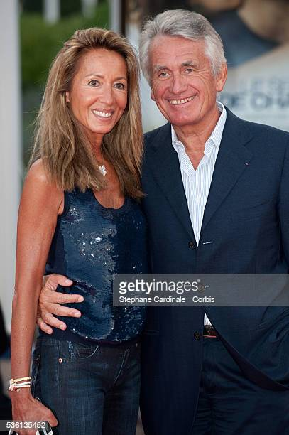 Gilbert Coullier and his wife Nicole attend the premiere of movie 'You Will Meet a Tall Dark Stranger' at the 36th American Film Festival in Deauville