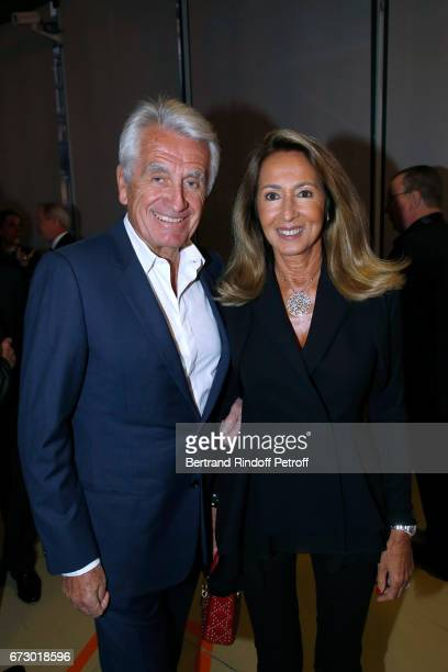 Gilbert Coullier and his wife Nicole pose in front the works of JeanPaul Goude during the 'Societe des Amis du Musee d'Art Moderne du Centre...