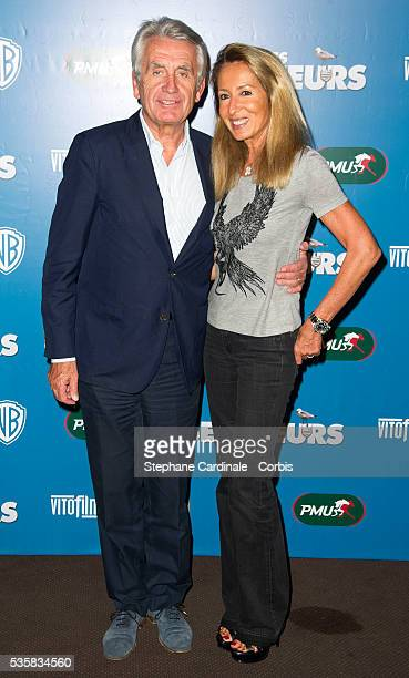 Gilbert Coullier and Nicole Coullier attend Les Seigneurs Premiere at Cinema Gaumont Marignan in Paris