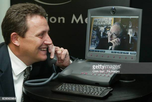 Gilbert Grosvenor the great grandson of telephone inventor Alexander Graham Bell talks on the latest video phone from his office at the National...