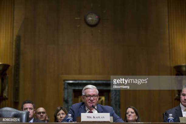 Gilbert Kaplan under secretary of commerce for international trade nominee for US President Donald Trump listens during a Senate Finance Committee...