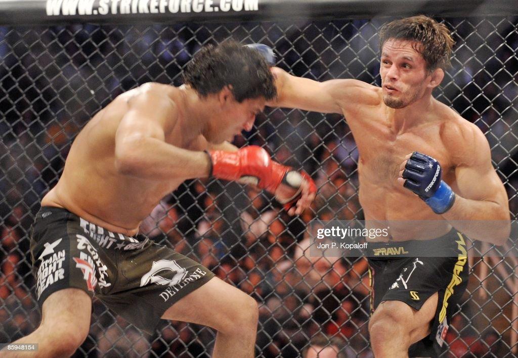 Gilbert Melendez (L) battles Rodrigo Damm at Strikeforce: Shamrock vs. Diaz at HP Pavilion on April 11, 2009 in San Jose, California.
