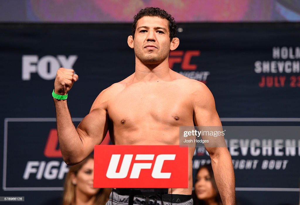 Gilbert Melendez poses on the scale during the UFC weigh-in at the United Center on July 22, 2016 in Chicago, Illinois.