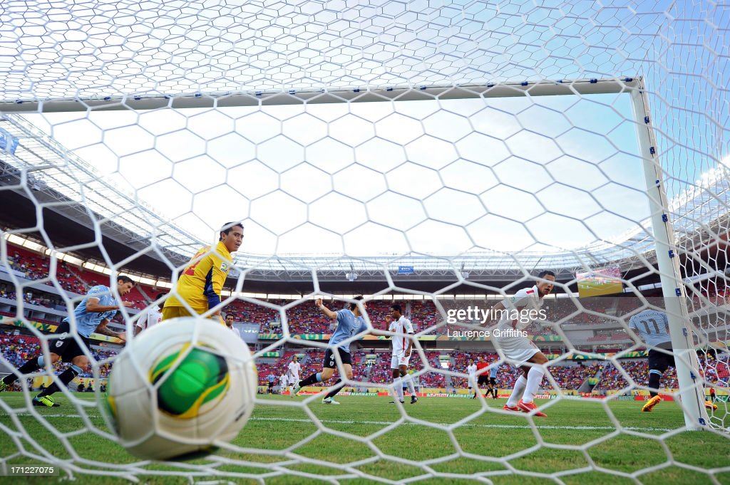 Gilbert Meriel of Tahiti looks on after giving up a goal against <a gi-track='captionPersonalityLinkClicked' href=/galleries/search?phrase=Abel+Hernandez&family=editorial&specificpeople=2292325 ng-click='$event.stopPropagation()'>Abel Hernandez</a> of Uruguay during the FIFA Confederations Cup Brazil 2013 Group B match between Uruguay and Tahiti at Arena Pernambuco on June 22, 2013 in Recife, Brazil.