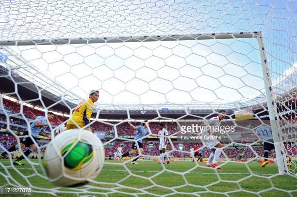 Gilbert Meriel of Tahiti looks on after giving up a goal against Abel Hernandez of Uruguay during the FIFA Confederations Cup Brazil 2013 Group B...