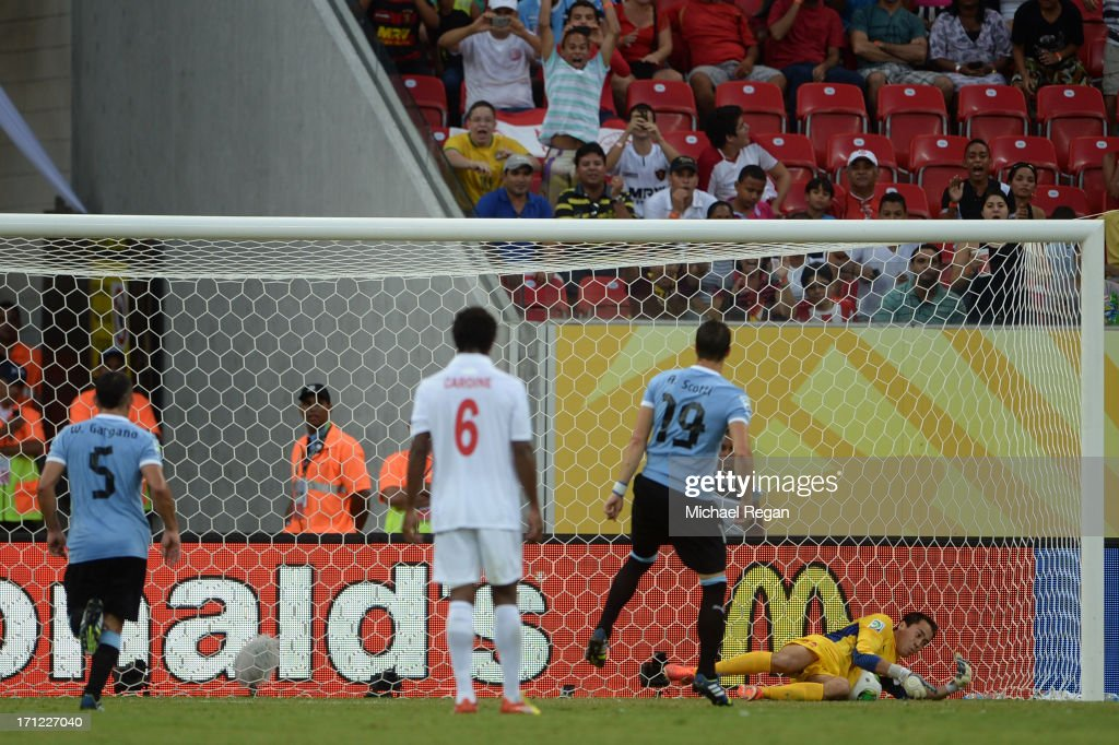 Gilbert Meriel of Tahiti makes the save on the penalty kick of <a gi-track='captionPersonalityLinkClicked' href=/galleries/search?phrase=Andres+Scotti&family=editorial&specificpeople=682110 ng-click='$event.stopPropagation()'>Andres Scotti</a> of Uruguay during the FIFA Confederations Cup Brazil 2013 Group B match between Uruguay and Tahiti at Arena Pernambuco on June 22, 2013 in Recife, Brazil.