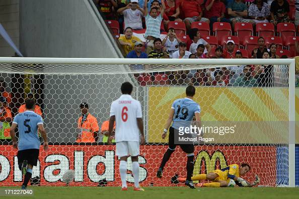 Gilbert Meriel of Tahiti makes the save on the penalty kick of Andres Scotti of Uruguay during the FIFA Confederations Cup Brazil 2013 Group B match...