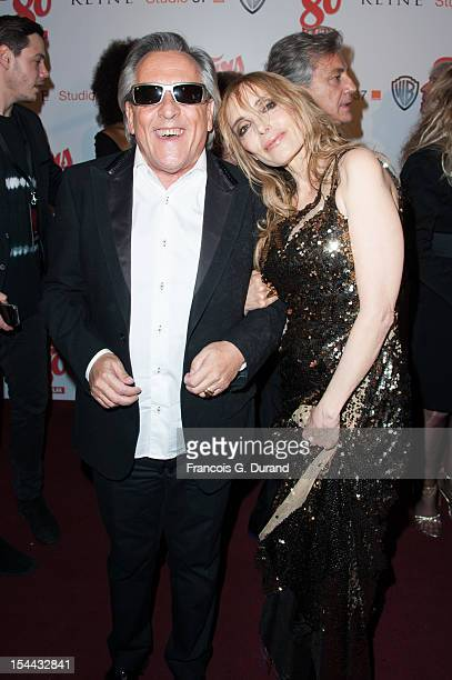 Gilbert Montagne and Jeanne Mas attend 'Stars 80' Film Premiere at Le Grand Rex on October 19 2012 in Paris France