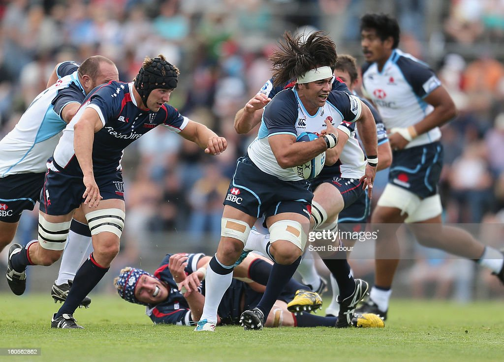 AJ Gilbert of the Waratahs is tackled during the Super Rugby trial match between the Waratahs and the Rebels at North Hobart Stadium on February 2, 2013 in Hobart, Australia.
