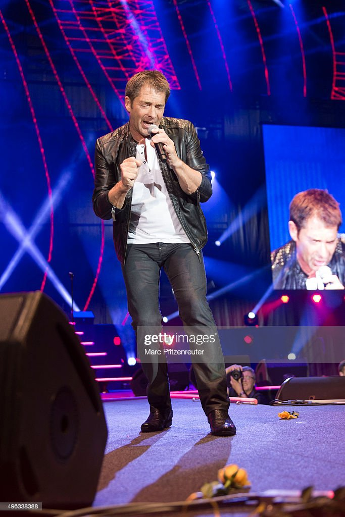 Gilbert performs onstage during the 'Schlager-Starparade' at the Koenig-Pilsener-Arena on November 8, 2015 in Oberhausen, Germany.