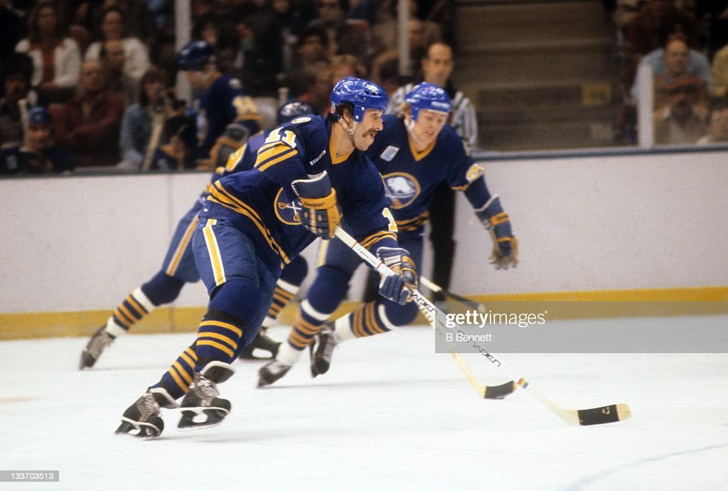 Gilbert Perreault of the Buffalo Sabres skates with the puck during an NHL game against the New York Islanders on October 13 1979 at the Nassau...