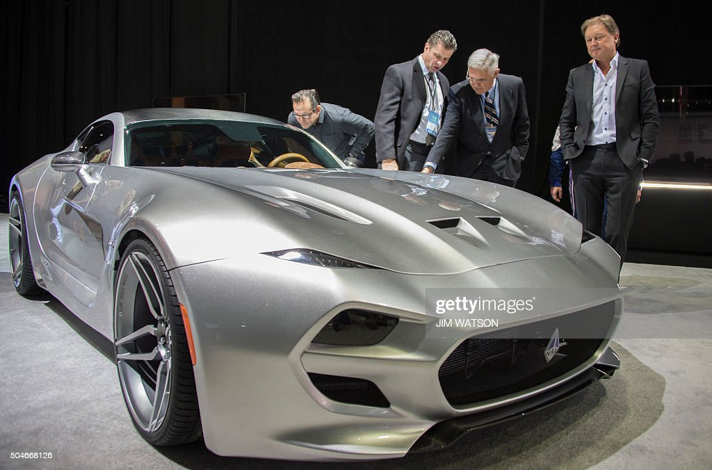 Gilbert Villarreal (2nd L), Bob Lutz (2nd R), and Fisker co-founder and namesake Henrik Fisker (R) unveil the VLF Coupe during the VLF press conference at the North American International Auto Show in Detroit, Michigan, January 12, 2016.