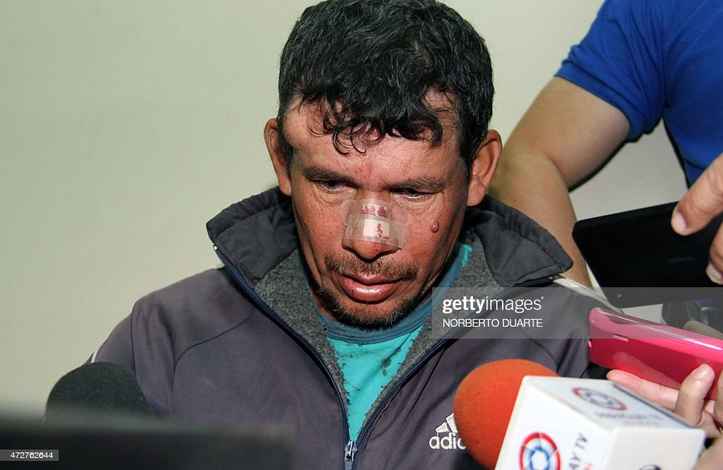 Gilberto Benitez Zarate accused of raping his 10yearold stepdaughter is hounded by the press after being arrested on May 9 2015 in Asuncion Benitez...