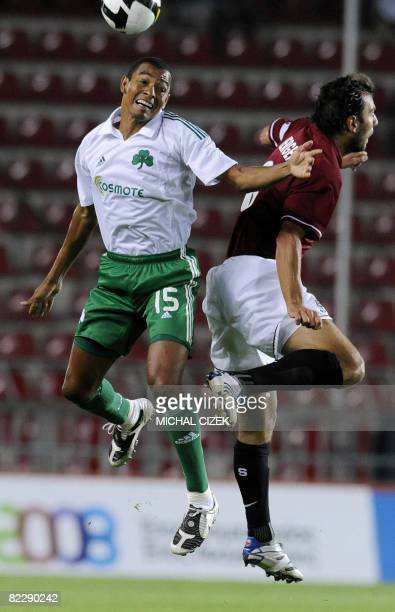 Gilberto da Silva of FC Panathinaikos Athens goes to a header with Patrick Berger of Sparta Prague during their Champions League third qualifying...