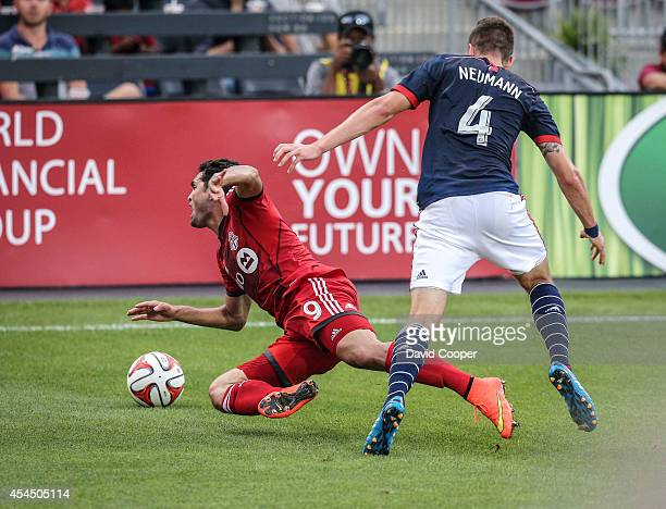 Gilberto for TFC is hauled down by Steve Neumann of the Revolution late in the game as Toronto FC looses 30 to the New England Revolution at BMO Field