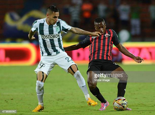 Gilberto Garcia of Atletico Nacional fights for the ball with Pablo Escobar of Cucuta Deportivo during a match between Atletico Nacional and Cucuta...