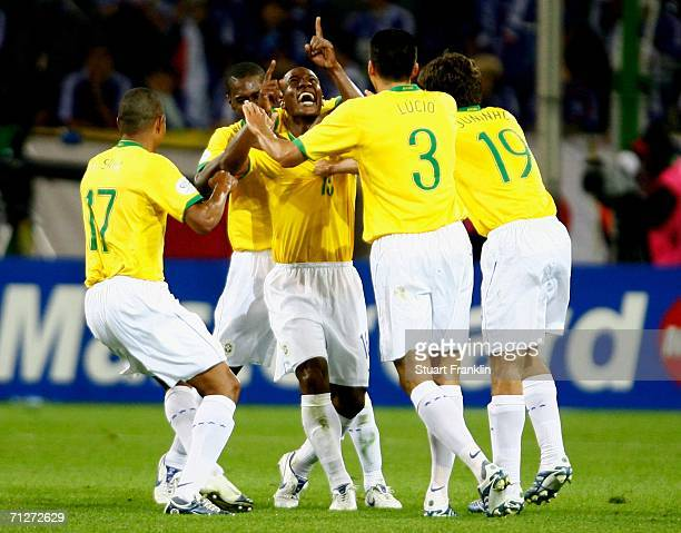 Gilberto of Brazil is congratulated by his team mates after scoring during the FIFA World Cup Germany 2006 Group F match between Japan and Brazil at...