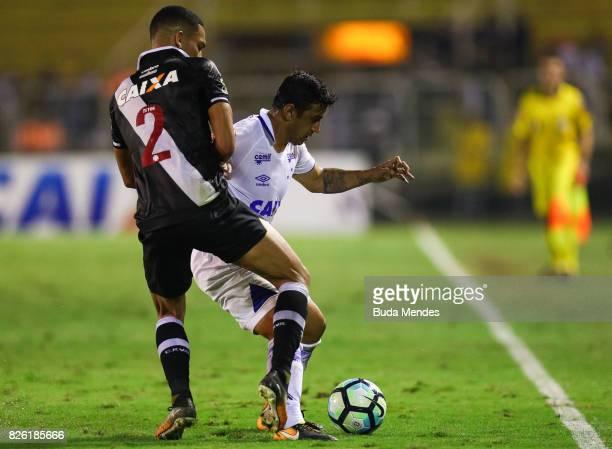 Gilberto of Vasco da Gama struggles for the ball with Robinho of Cruzeiro during a match between Vasco da Gama and Cruzeiro as part of Brasileirao...