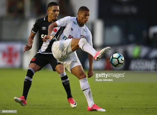 Gilberto of Vasco struggles for the ball with Richarlison of Fluminense during a match between Vasco and Fluminense part of Brasileirao Series A 2017...