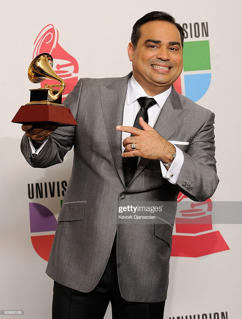 Gilberto Santa Rosa Gramy winner for Traditional Tropical Album poses in the press room during the 10th annual Latin GRAMMY Awards held at Mandalay...