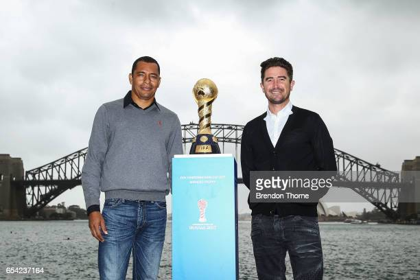 Gilberto Silva and Harry Kewell pose with the 2017 FIFA Confederations Cup at Blues Point Reserve on March 17 2017 in Sydney Australia