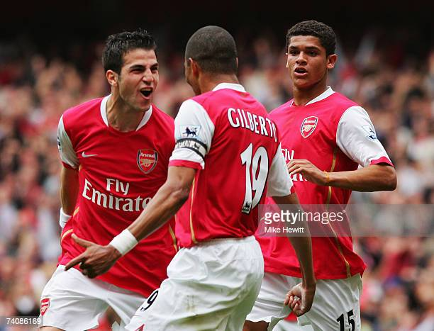 Gilberto Silva of Arsenal celebrates with Francesc Fabregas and Denilson as he scores their first goal from the penalty spot during the Barclays...