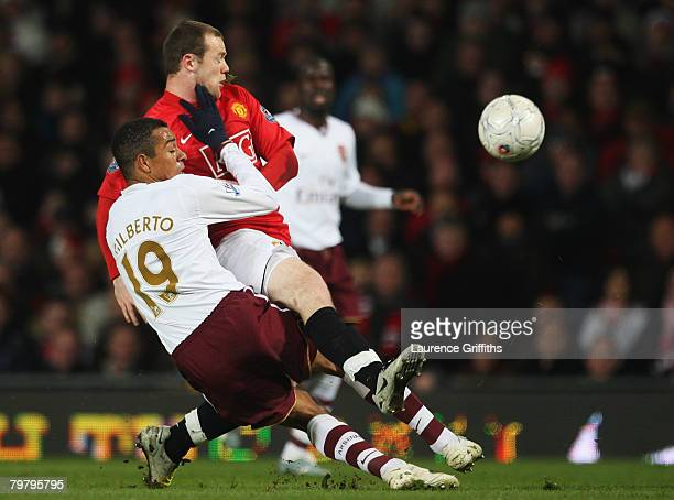 Gilberto Silva of Arsenal challenges Wayne Rooney of United during the FA Cup spnsored by EON 5th Round match between Manchester United and Arsenal...