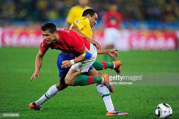 Gilberto Silva of Brazil tackles Cristiano Ronaldo of Portugal during the 2010 FIFA World Cup South Africa Group G match between Portugal and Brazil...