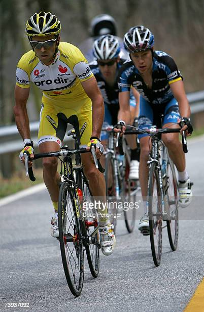 Gilberto Simoni of Italy and riding for Saunier Duval Prodir is marked by Tom Danielson and Levi Leipheimer of the USA and riding for the Discovery...