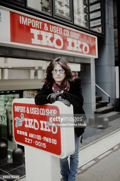 Gilby Clarke Guns N' Roses in front of imported CD shop in Nishi Shinjuku Tokyo January 1992