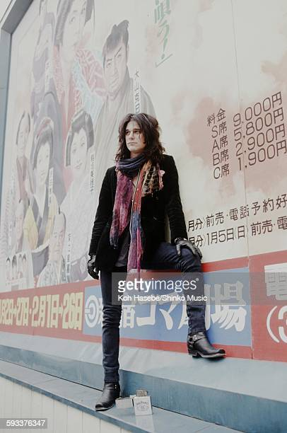 Gilby Clarke Guns N' Roses in front of theater signboard in Shinjuku Tokyo January 1992