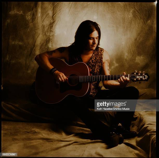Gilby Clarke Guns N' Roses playing acoustic guitar in studio photo session Tokyo January 1992