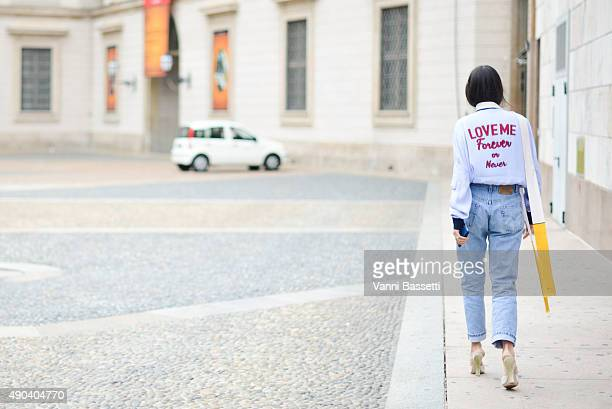 Gilda Ambrosio arrives at the Arthur Arbesser show wearing an Andrea Pompilio shirt during the Milan Fashion Week Spring/Summer 16 on September 28...