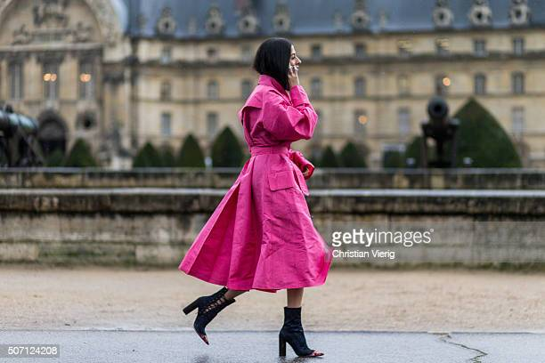Gilda Ambrosio is wearing a pink coat by Alessandra Rich outside Maison Margiela during the Paris Fashion Week Haute Couture Spring/Summer 2016 on...