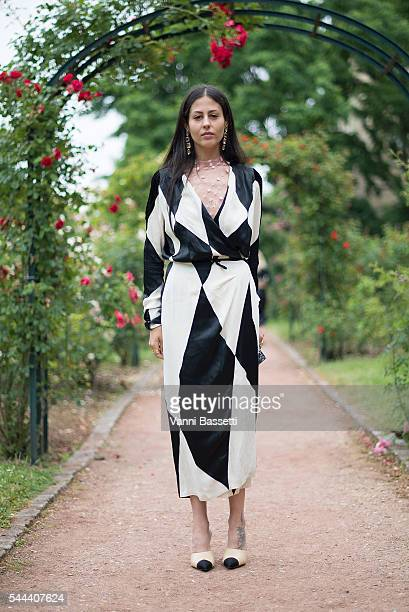 Gilda Ambrosio poses wearing an Attico dress before the Ulyana Sergeenko show at Galerie de la Mineralogie during Paris Fashion Week Haute Couture...