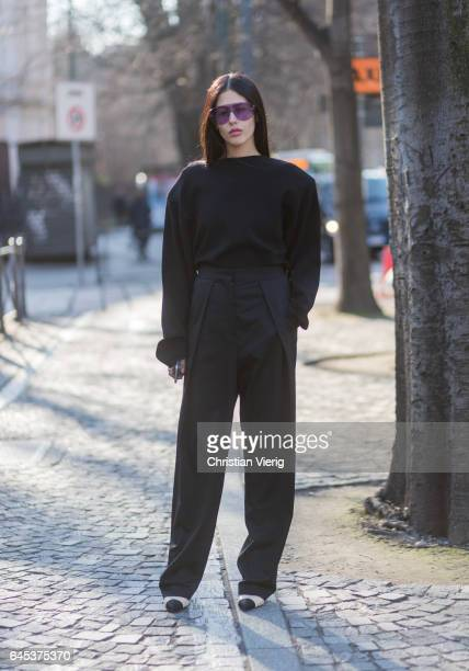 Gilda Ambrosio wearing a black sweater black pants outside Jil Sander during Milan Fashion Week Fall/Winter 2017/18 on February 25 2017 in Milan Italy