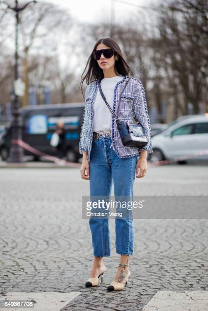 Gilda Ambrosio wearing a Chanel jacket denim jeans Chanel heels outside Chanel on March 7 2017 in Paris France