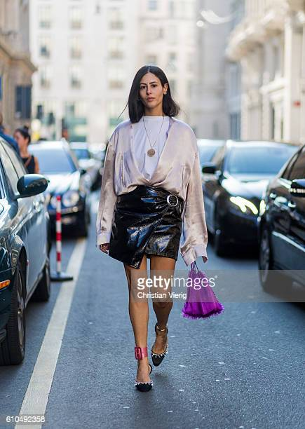 Gilda Ambrosio wearing a latex skirt outside Ferragamo during Milan Fashion Week Spring/Summer 2017 on September 25 2016 in Milan Italy