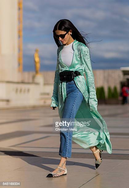 Gilda Ambrosio wearing a mint coat black Chanel bag denim jeans outside Giorgio Armani Prive during Paris Fashion Week Haute Couture F/W 2016/2017 on...