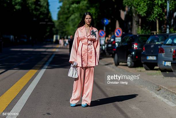 Gilda Ambrosio wearing a pink pyjama outside Fendi during the Milan Men's Fashion Week Spring/Summer 2017 on June 20 2016 in Milan Italy