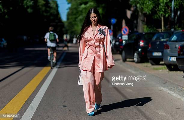 Gilda Ambrosio wearing a pink pyjama outside Fendi during the Milan Men's Fashion Week Spring/Summer 2017 on June 20 2016 in Milan Italy