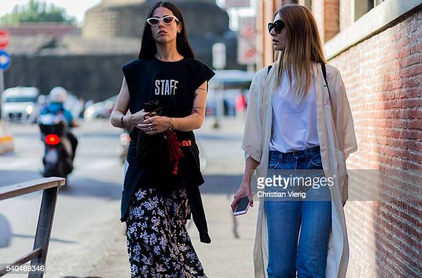 Gilda Ambrosio wearing a Vetements hoody sleeveless top platform sandals and Giorgia Tordini during Pitti Uomo 90 on June 15 in Florence Italy