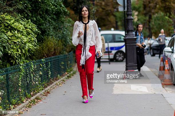 Gilda Ambrosio wearing a white blouse and red pants outside Chloe on September 29 2016 in Paris France