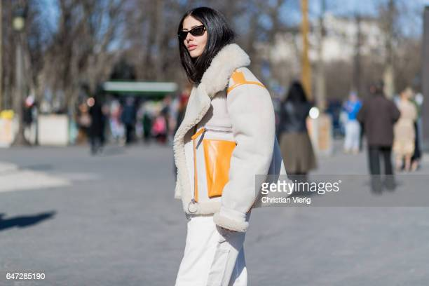 Gilda Ambrosio wearing a white wide leg pants outside Chloe on March 2 2017 in Paris France