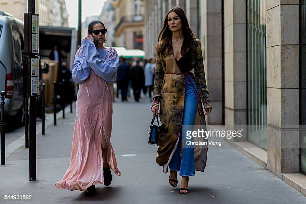 Gilda Ambrosio wearing Attico dress and Chiara Capitani outside Iris van Herpen during Paris Fashion Week Haute Couture F/W 2016/2017 on July 4 2016...