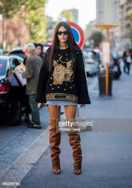 Gilda Ambrosio wearing brown overknee boots is seen outside Alberta Ferretti during Milan Fashion Week Spring/Summer 2018 on September 20 2017 in...