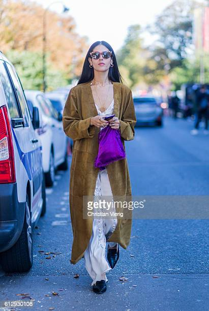 Gilda Ambrosio wearing velvet outside Moncler Gamme Rouge on October 5 2016 in Paris France